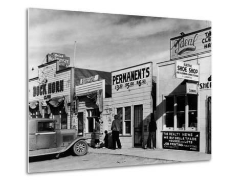 Beauty Parlor Advertising: Permanents: $3.50, $5.00 and $6.50, Shack Town, Fort Peck Dam-Margaret Bourke-White-Metal Print