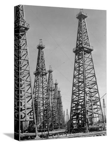 Oil Well Rigs in a Texaco Oil Field-Margaret Bourke-White-Stretched Canvas Print