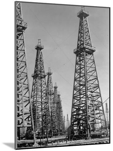 Oil Well Rigs in a Texaco Oil Field-Margaret Bourke-White-Mounted Photographic Print