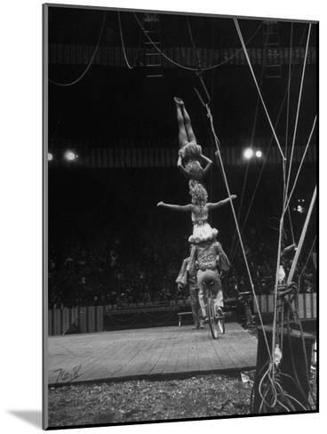 Circus Stacked Up Trio Casually Bicycling around the Board-Ralph Morse-Mounted Photographic Print