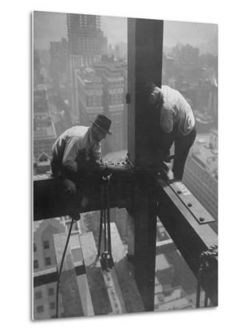 Workmen Attaching Steel Beams High Above Street During Construction of Manhattan Company Building-Arthur Gerlach-Metal Print