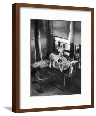 Victoria Cooper's Children Peering in Window Where Newborn Baby Lies in Crib Made from Fruit Crate-W^ Eugene Smith-Framed Art Print