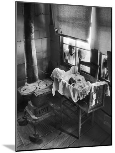 Victoria Cooper's Children Peering in Window Where Newborn Baby Lies in Crib Made from Fruit Crate-W^ Eugene Smith-Mounted Photographic Print