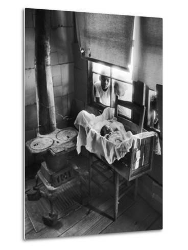Victoria Cooper's Children Peering in Window Where Newborn Baby Lies in Crib Made from Fruit Crate-W^ Eugene Smith-Metal Print