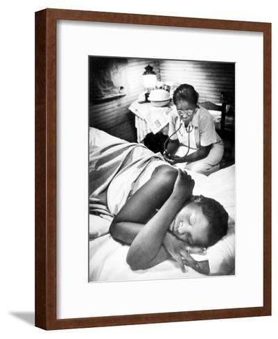Famous Midwife-Nurse Maude Callen, Attending a Woman in Labor-W^ Eugene Smith-Framed Art Print