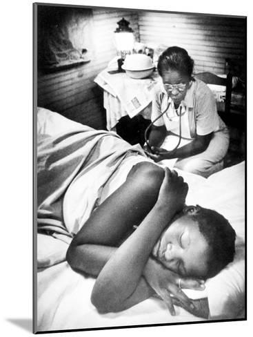 Famous Midwife-Nurse Maude Callen, Attending a Woman in Labor-W^ Eugene Smith-Mounted Photographic Print