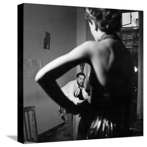 Christian Berard Sketching a Model in the Offices of Paris Vogue-Roger Schall-Stretched Canvas Print