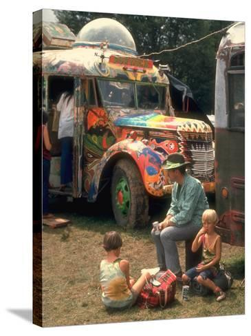 Man Seated with Two Young Boys in Front of a Wildly Painted School Bus, Woodstock Music Art Fest-John Dominis-Stretched Canvas Print