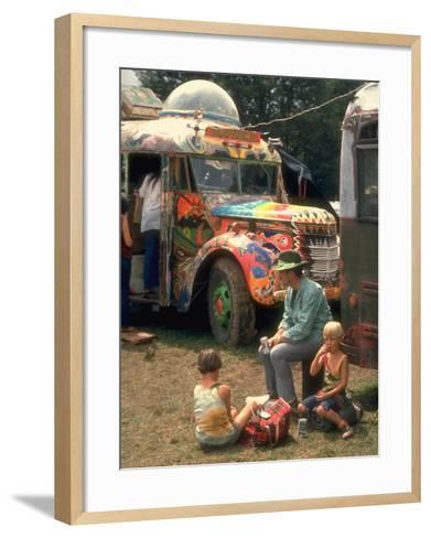 Man Seated with Two Young Boys in Front of a Wildly Painted School Bus, Woodstock Music Art Fest-John Dominis-Framed Art Print