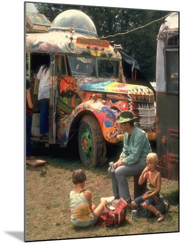 Man Seated with Two Young Boys in Front of a Wildly Painted School Bus, Woodstock Music Art Fest-John Dominis-Mounted Photographic Print