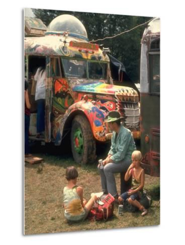 Man Seated with Two Young Boys in Front of a Wildly Painted School Bus, Woodstock Music Art Fest-John Dominis-Metal Print