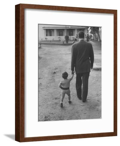 President Gamal Abdul Nasser at His Home with His Small Son Just after Port Said Invasion-Howard Sochurek-Framed Art Print