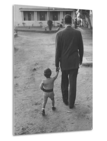 President Gamal Abdul Nasser at His Home with His Small Son Just after Port Said Invasion-Howard Sochurek-Metal Print