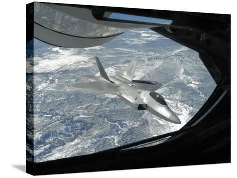 F-22 Raptor Banks Away from a KC-135 Statotanker During a Refueling Operation-Stocktrek Images-Stretched Canvas Print