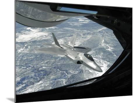 F-22 Raptor Banks Away from a KC-135 Statotanker During a Refueling Operation-Stocktrek Images-Mounted Photographic Print