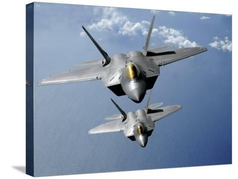 Two F-22 Raptors Fly over the Pacific Ocean-Stocktrek Images-Stretched Canvas Print