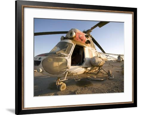 Iraqi Helicopter Sits on the Flight Deck Abandoned at Camp Warhorse-Stocktrek Images-Framed Art Print