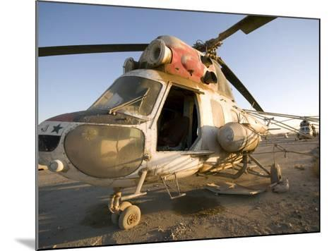 Iraqi Helicopter Sits on the Flight Deck Abandoned at Camp Warhorse-Stocktrek Images-Mounted Photographic Print