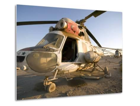 Iraqi Helicopter Sits on the Flight Deck Abandoned at Camp Warhorse-Stocktrek Images-Metal Print