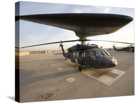UH-60 Blackhawk Medivac Helicopter Sits on the Flight Deck at Camp Warhorse-Stocktrek Images-Stretched Canvas Print