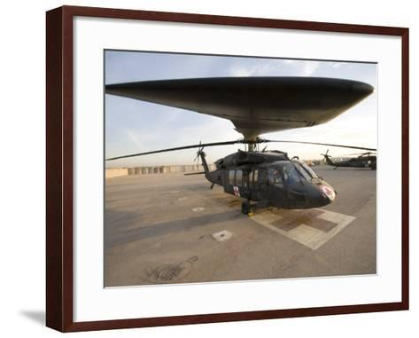 UH-60 Blackhawk Medivac Helicopter Sits on the Flight Deck at Camp Warhorse-Stocktrek Images-Framed Art Print