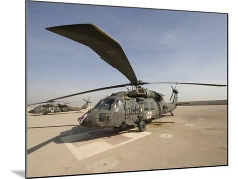UH-60 Blackhawk Medivac Helicopter Sits on the Flight Deck at Camp Warhorse-Stocktrek Images-Mounted Photographic Print