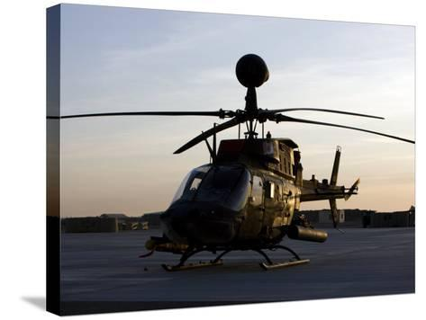 OH-58D Kiowa During Sunset-Stocktrek Images-Stretched Canvas Print