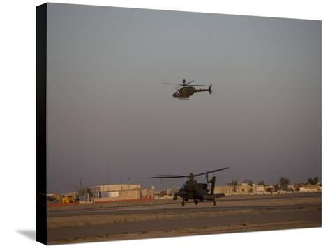 AH-64 Apache Helicopter Waits for an OH-58 Kiowa to Clear His Flight Space-Stocktrek Images-Stretched Canvas Print