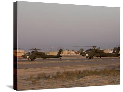 Pair of AH-64 Apache Helicopters Prepare for Takeoff-Stocktrek Images-Stretched Canvas Print