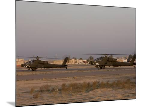 Pair of AH-64 Apache Helicopters Prepare for Takeoff-Stocktrek Images-Mounted Photographic Print
