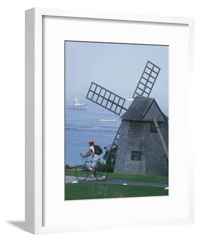 Bicyclist Rides Past a Windmill on a Cape Cod Shore, Chatham, Massachusetts-Darlyne A^ Murawski-Framed Art Print
