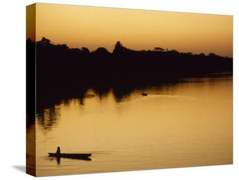 People in Canoes on the Calm Waters of the Amazon River, Amazon River, Colombia and Peru-Marcia Kebbon-Stretched Canvas Print