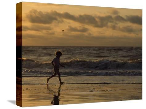 Five Year Old Boy Runs Through the Surf, Tybee Island, Georgia-Brian Gordon Green-Stretched Canvas Print