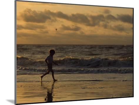 Five Year Old Boy Runs Through the Surf, Tybee Island, Georgia-Brian Gordon Green-Mounted Photographic Print
