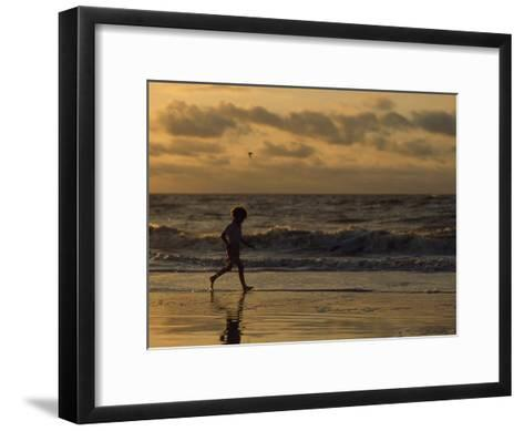 Five Year Old Boy Runs Through the Surf, Tybee Island, Georgia-Brian Gordon Green-Framed Art Print