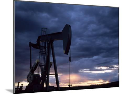 Oil Rig Silhouetted at Sunset, Adobe Town, Wyoming-Joel Sartore-Mounted Photographic Print