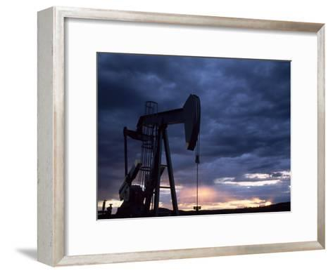 Oil Rig Silhouetted at Sunset, Adobe Town, Wyoming-Joel Sartore-Framed Art Print
