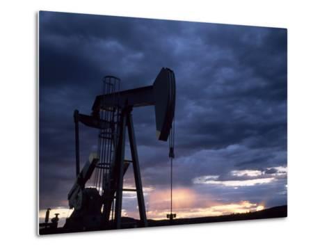 Oil Rig Silhouetted at Sunset, Adobe Town, Wyoming-Joel Sartore-Metal Print