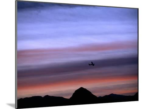 Aircraft and Mountains Silhouetted Against a Dramatic Sky at Dusk, Wyoming-Joel Sartore-Mounted Photographic Print