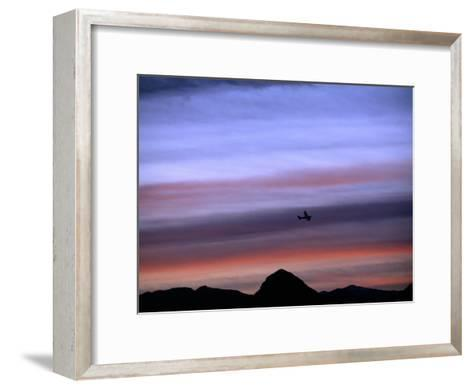 Aircraft and Mountains Silhouetted Against a Dramatic Sky at Dusk, Wyoming-Joel Sartore-Framed Art Print