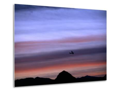 Aircraft and Mountains Silhouetted Against a Dramatic Sky at Dusk, Wyoming-Joel Sartore-Metal Print