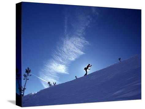 Silhouette of a Woman Cross Country Skiing Up a Snowy Slope, Mount Rose, Nevada, United States-Kate Thompson-Stretched Canvas Print
