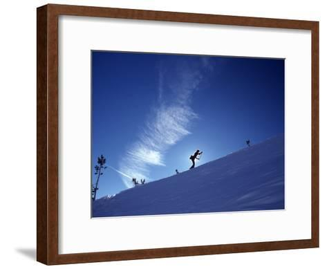 Silhouette of a Woman Cross Country Skiing Up a Snowy Slope, Mount Rose, Nevada, United States-Kate Thompson-Framed Art Print