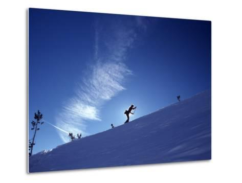 Silhouette of a Woman Cross Country Skiing Up a Snowy Slope, Mount Rose, Nevada, United States-Kate Thompson-Metal Print