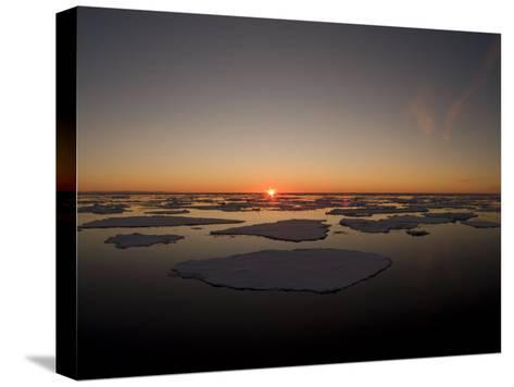Beautiful Sunset over an Arctic Ice Field, Svalbard, Norway-Norbert Rosing-Stretched Canvas Print