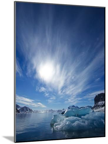 Blue Ice under a Blue Sky with Streaky Clouds, Hornsund, Spitsbergen Island, Svalbard, Norway-Ralph Lee Hopkins-Mounted Photographic Print
