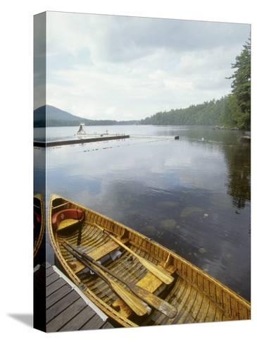 Canoe Floats Next to a Dock, Sebago Lake, Maine-Skip Brown-Stretched Canvas Print