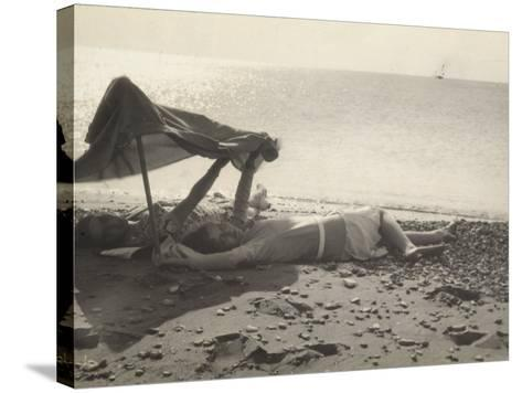 Two Women Lying on the Sea Shore in the Shade of a Towel-Ludovico Pacho-Stretched Canvas Print