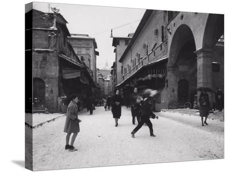 Ponte Vecchio with Snow-Vincenzo Balocchi-Stretched Canvas Print