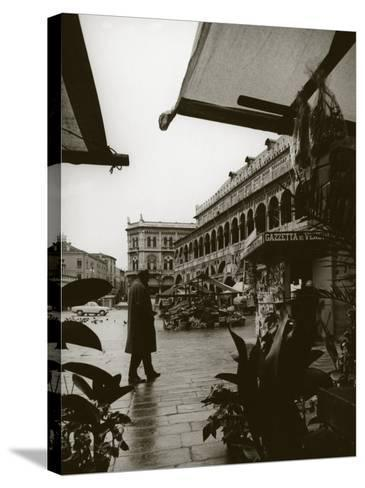 Stands and a Bookstall Keeper in Front of the Palazzo Della Ragione, in Padua-A^ Villani-Stretched Canvas Print